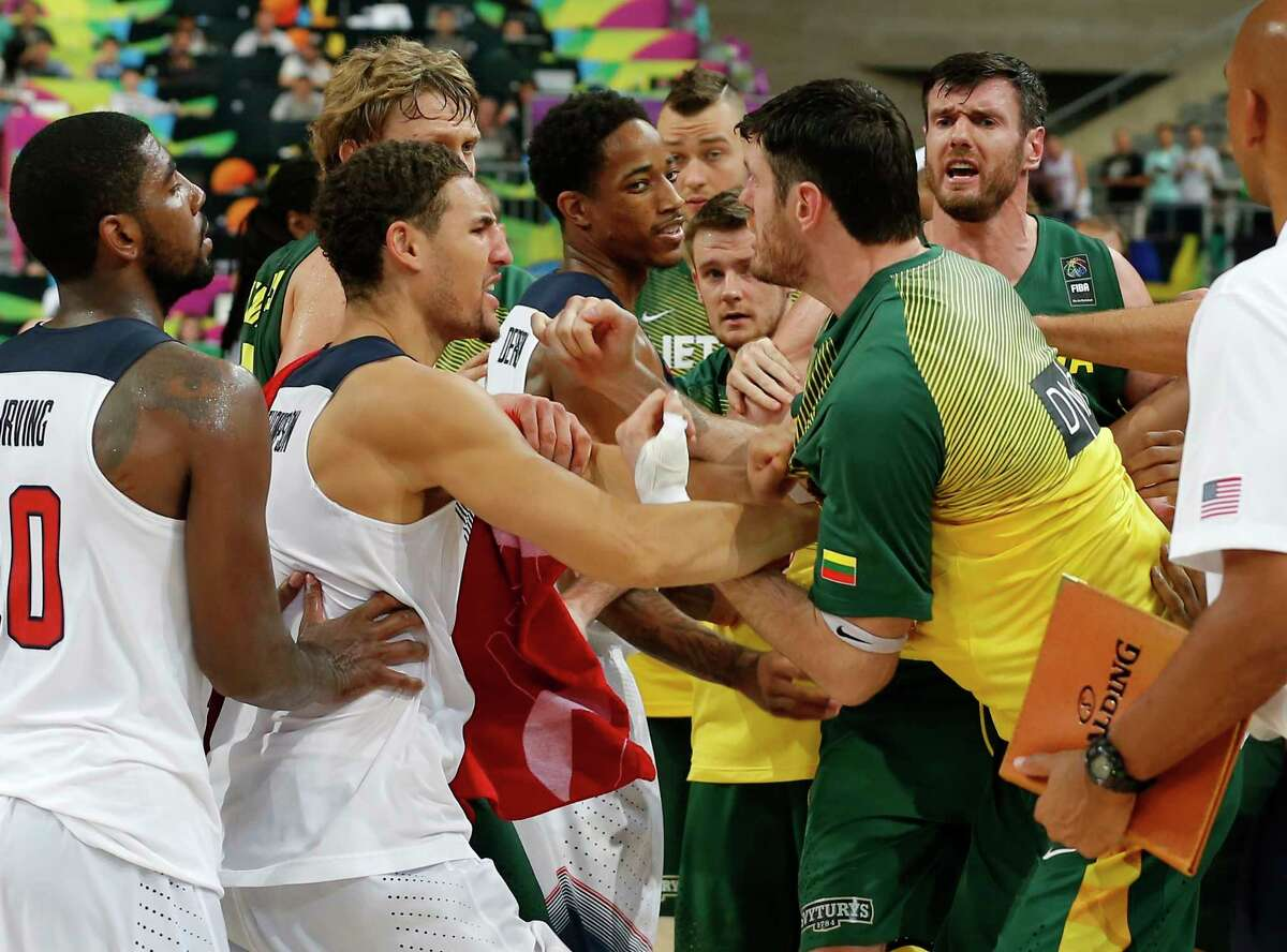U.S. and Lithuania players scuffle after their Basketball World Cup semifinal Thursday at the Palau Sant Jordi in Barcelona, Spain.