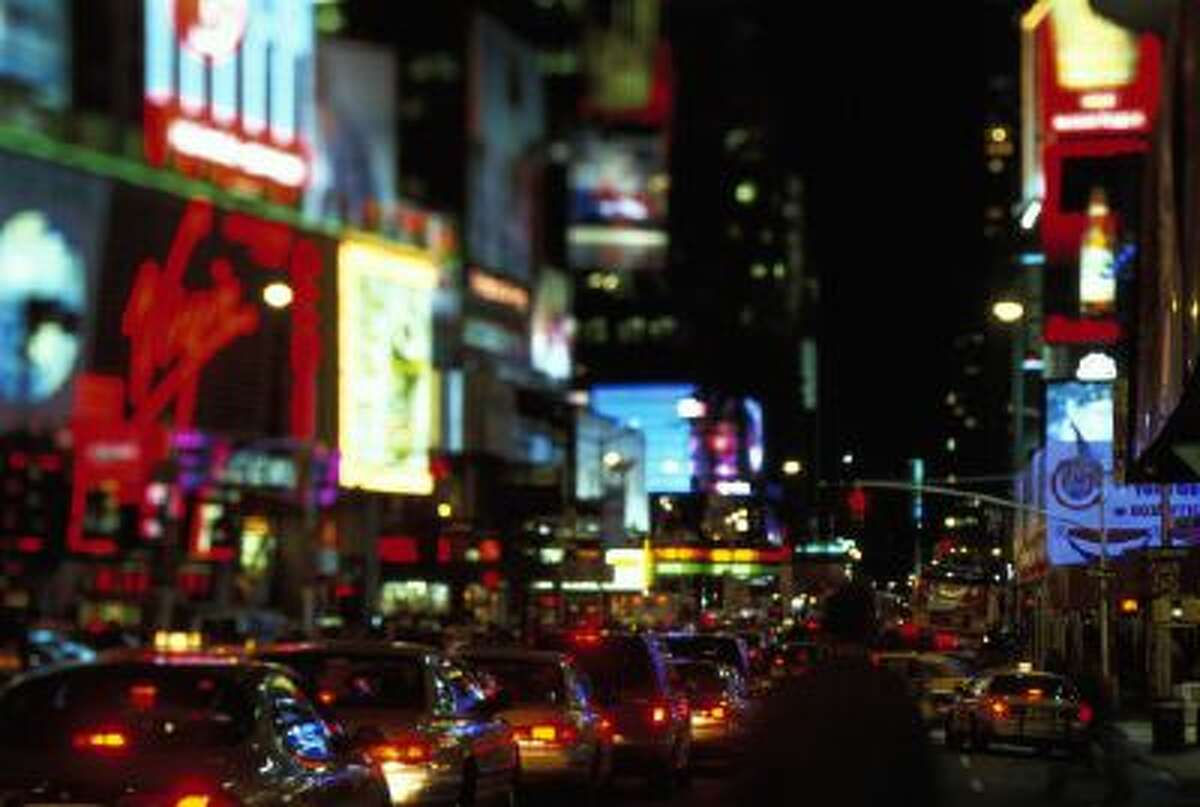 Times Square traffic at night in New York City, New York.