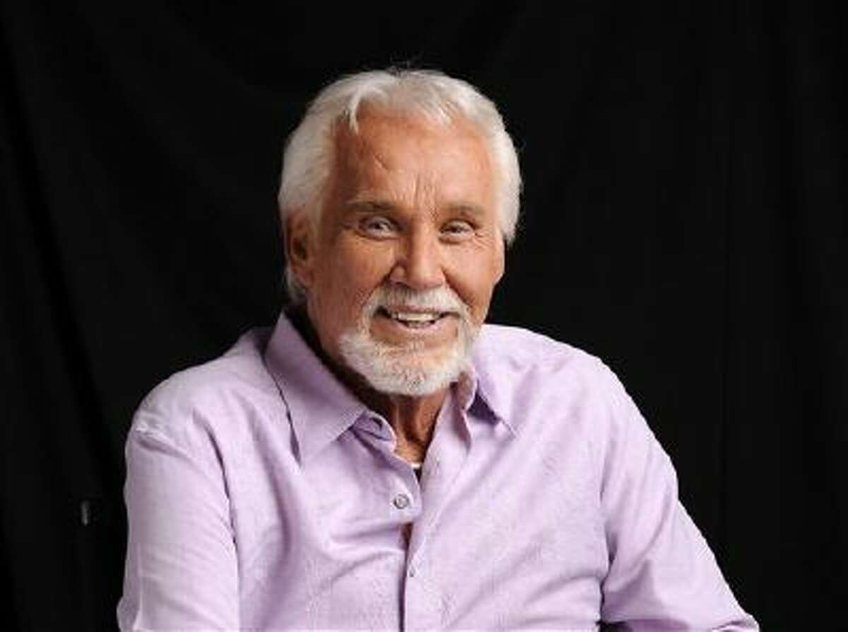 In this Sept. 4, 2013 file photo, Kenny Rogers poses for a portrait at The Hot Seat in Nashville, Tenn.