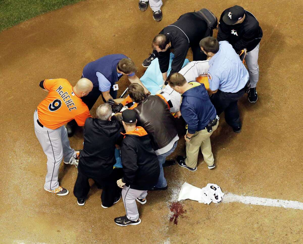 Miami Marlins' Giancarlo Stanton is taken off the field on a stretcher after being hit in the face with a pitch during the fifth inning against the Brewers on Thursday.