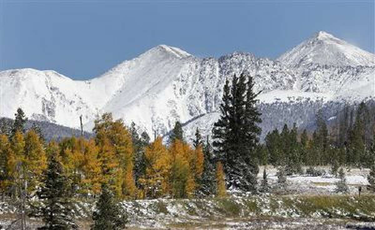 Fresh snow covers the mountain peaks east of Frisco, Colo., Oct. 5. A winter storm swept across the central Rocky Mountains in a blend of winter and autumn.