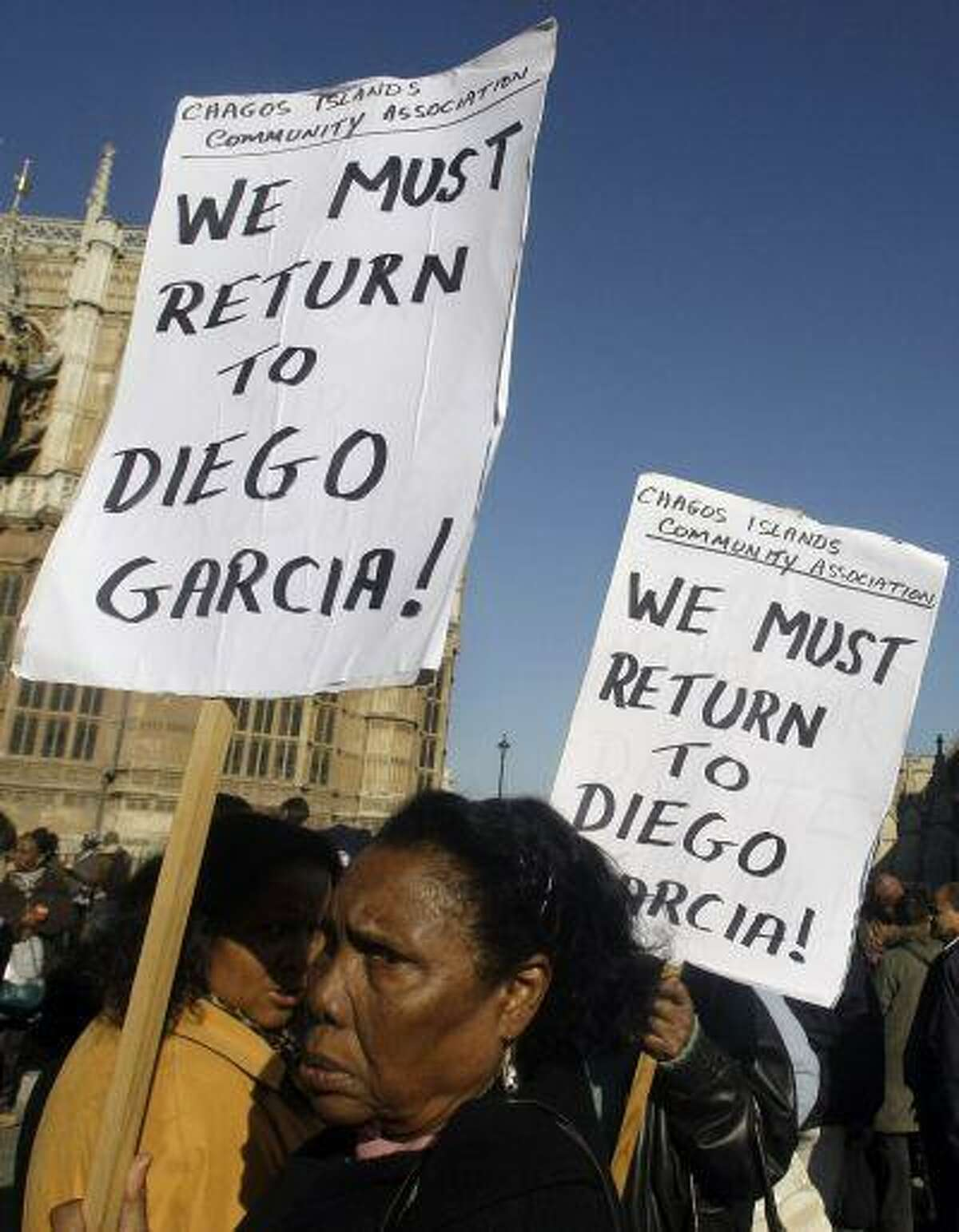 Women take part in a protest outside the Houses of Parliament in London, after a court ruling decided Chagos Islanders are not allowed to return to their homeland, Wednesday Oct. 22, 2008.