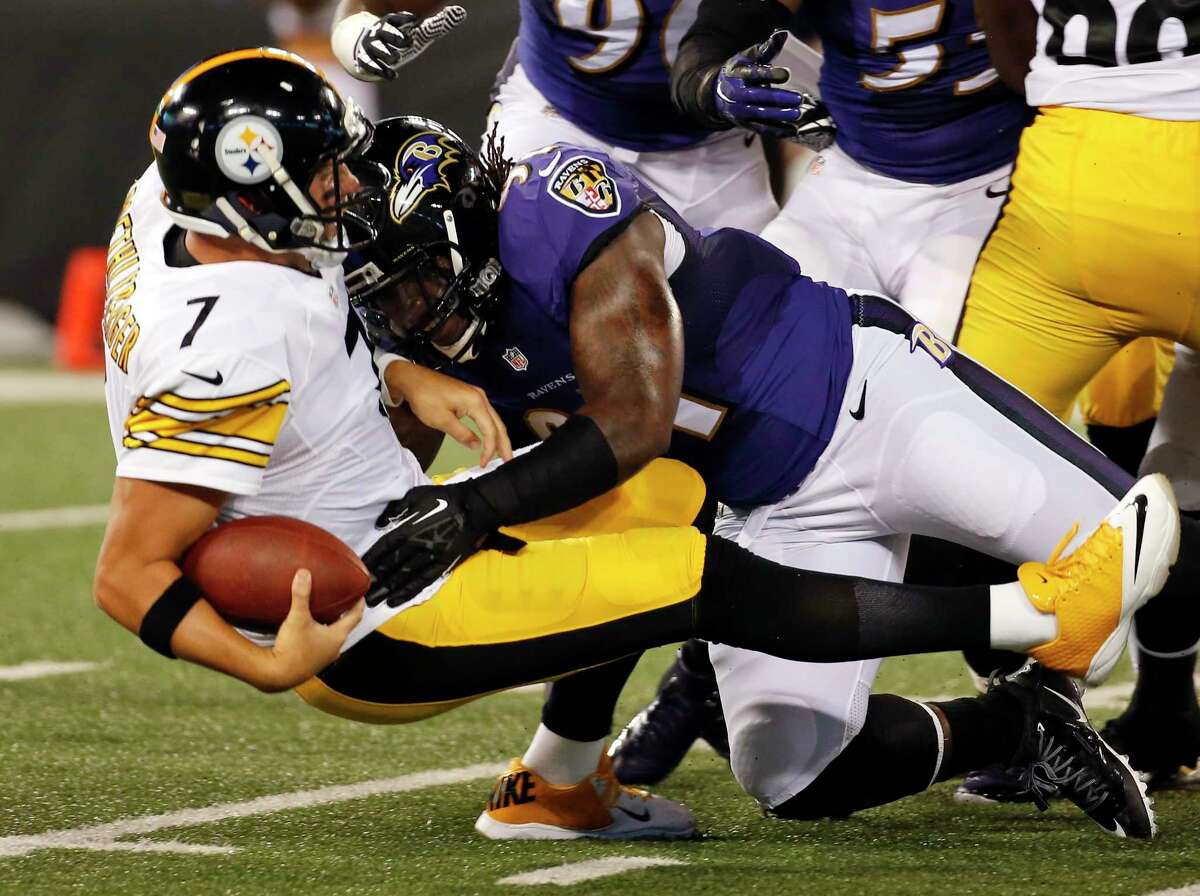 Steelers quarterback Ben Roethlisberger (7) is sacked by Ravens outside linebacker Courtney Upshaw during the first half Thursday.