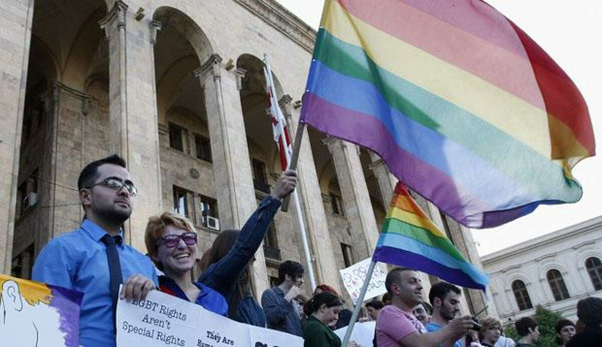 Gay rights activists stage a protest at the parliament building in Tbilisi, Georgia, Friday, May 18, 2012. They are protesting against homophobia and demanded marriage rights for gay and lesbian couples. (AP Photo/Shakh Aivazov)