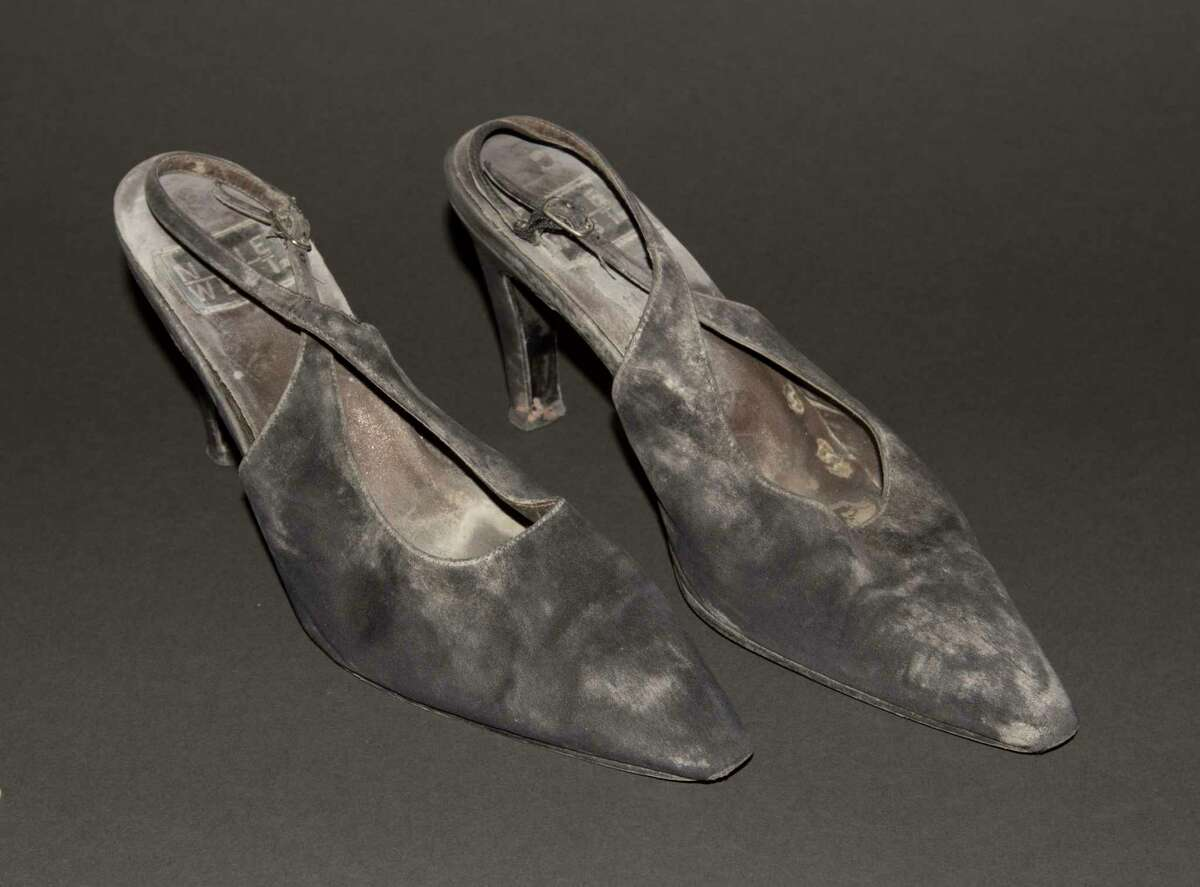 A pair of high-heel shoes worn by JoAnne Capestro while descending 87 floors of stairs to escape a World Trade center tower on Sept. 11, 2001.