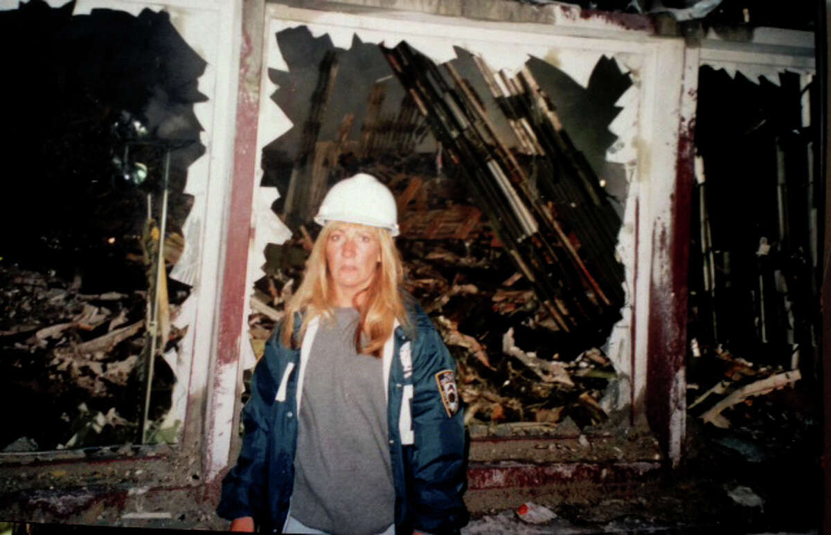 NYPD Detective Carol Orazem works at the World Trade center after the terrorist attacks of September 11, 2001.