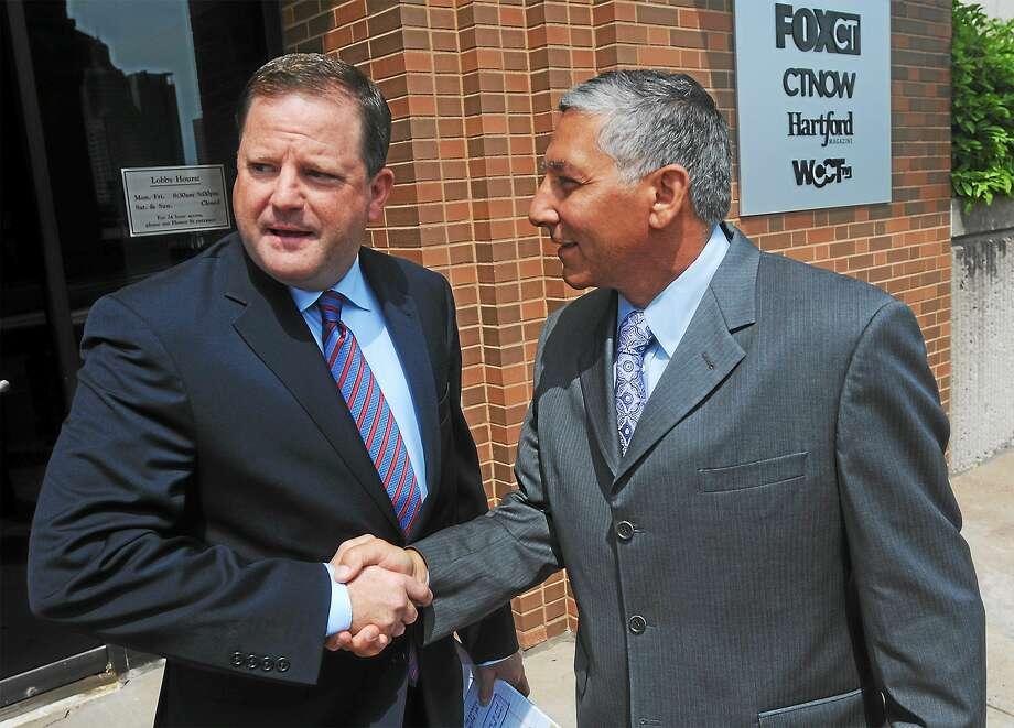 Connecticut state Senate Minority Leader John McKinney (left) shakes hands with state Sen. Len Fasano (right). Photo: AP Photo/Hartford Courant, Brad Horrigan, Pool  / Hartford Courant Pool