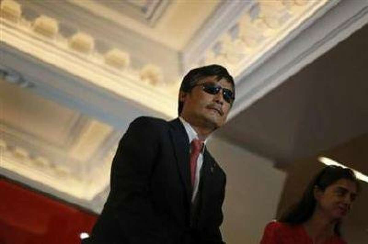 Chinese dissident Chen Guangcheng speaks to journalists following an appearance in New York May 3. (Brendan McDermid/Reuters)