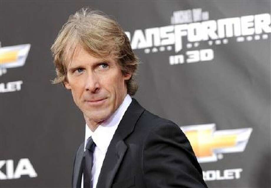 "In this June 28, 2011 file photo, executive producer and director Michael Bay attends the ""Transformers: Dark Of The Moon"" premiere in Times Square in New York. Photo: AP / AGOEV"