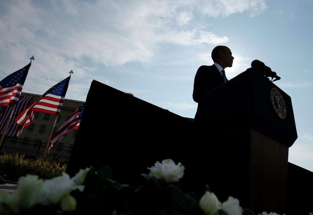 President Barack Obama speaks at the Pentagon, Thursday, Sept. 11, 2014, during a ceremony to mark the 13th anniversary of the 9/11 attacks. (AP Photo/Charles Dharapak)