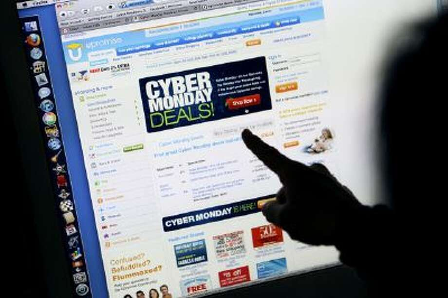 Consumer Carol Uyeno looks at Cyber Monday sales on her computer.