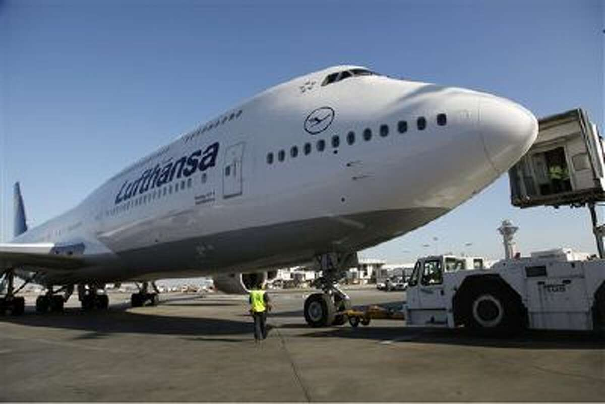In this Monday, Dec. 10, 2012, file photo, Lufthansa's Boeing 747-8 Brandenburg aircraft arrives at Los Angeles International Airport, after its inaugural passenger flight from Frankfurt, Germany to Los Angeles.
