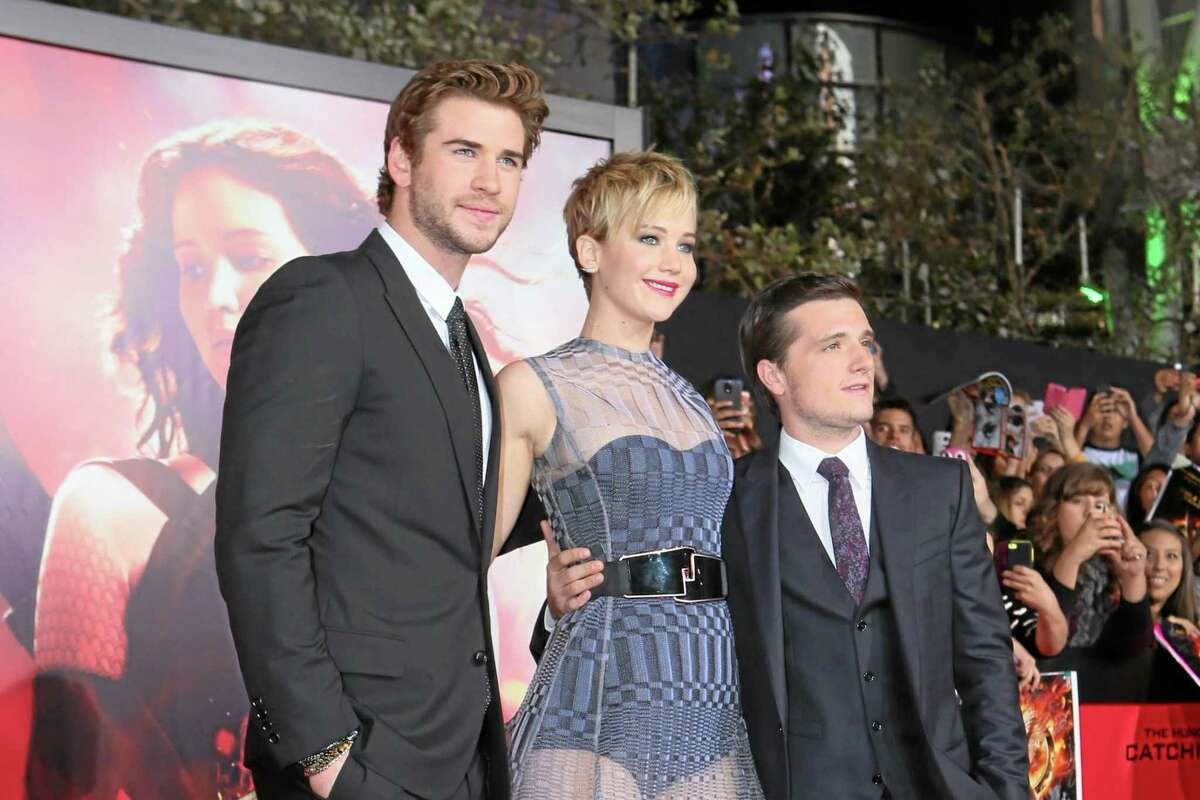 """Liam Hemsworth, left, Jennifer Lawrence and Josh Hutcherson seen at Lionsgate's """"The Hunger Games: Catching Fire"""" Los Angeles Premiere, on Monday, Nov, 18, 2013, in Los Angeles."""