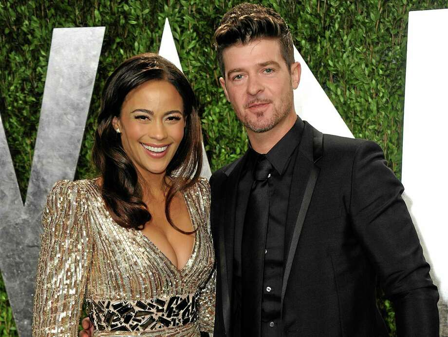 In this Feb. 24, 2013, file photo, Paula Patton and Robin Thicke arrive at the 2013 Vanity Fair Oscars Viewing and After Party at the Sunset Plaza Hotel in West Hollywood, Calif. Photo: (Jordan Strauss — The Associated Press) / Invision