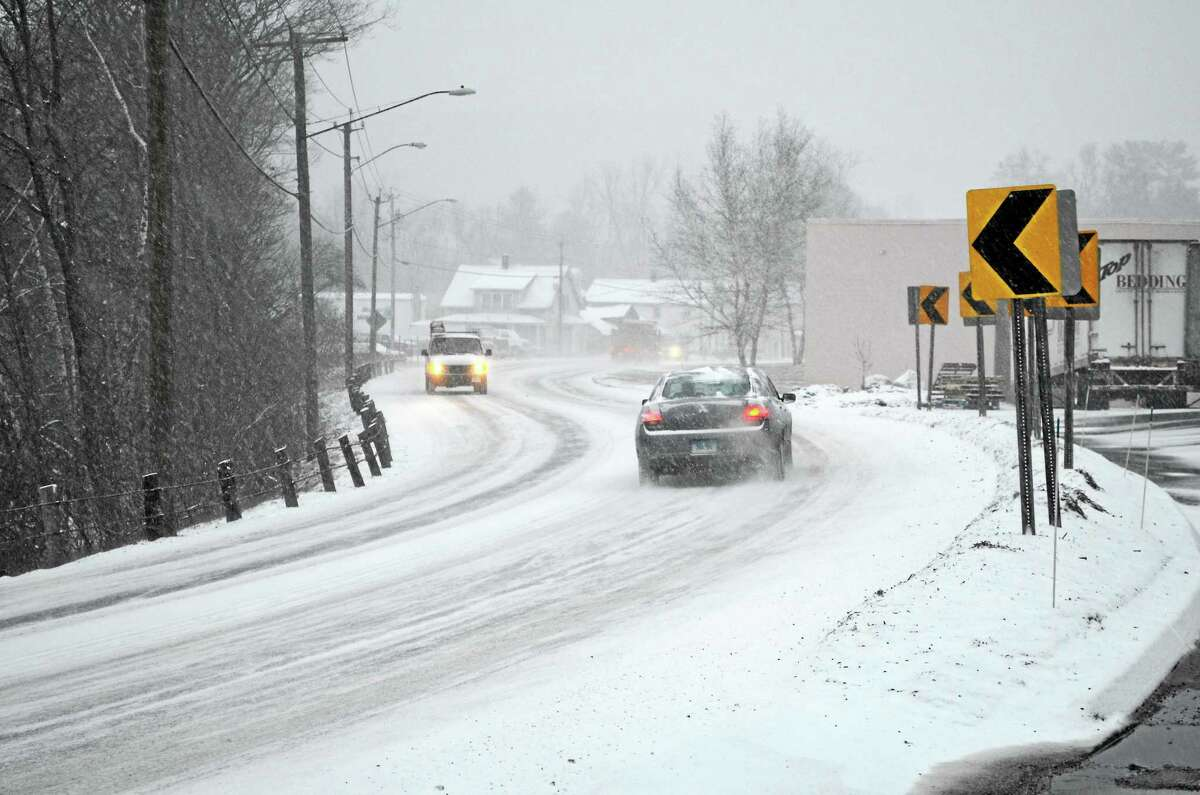 Traffic on South Main St. was slow as snow began to fall Tuesday afternoon.