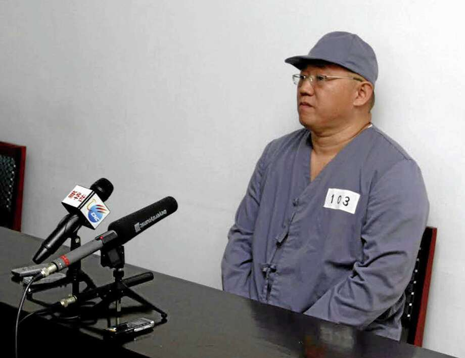 American missionary Kenneth Bae speaks to reporters at Pyongyang Friendship Hospital in Pyongyang Monday, Jan. 20, 2014. Bae, 45, who has been jailed in North Korea for more than a year, appealed for the U.S. to do its best to secure his release. (AP Photo/Kim Kwang Hyon) Photo: AP / AP