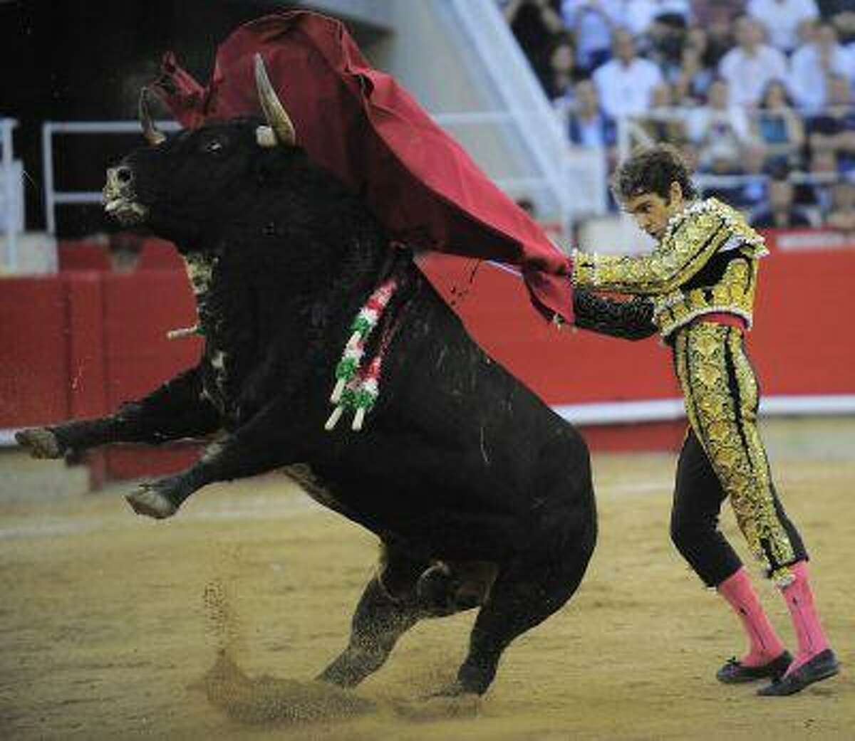 Spanish bullfighter Jose Tomas performs in the final bullfight to be held in the region of Catalonia at the Monumental bullring in Barcelona, Spain, Sunday, Sept. 25, 2011. Spain's powerful northeastern region of Catalonia bids farewell Sunday to the country's emblematic tradition of bullfighting with a final bash at the Barcelona bullring. (AP Photo/Manu Fernandez)