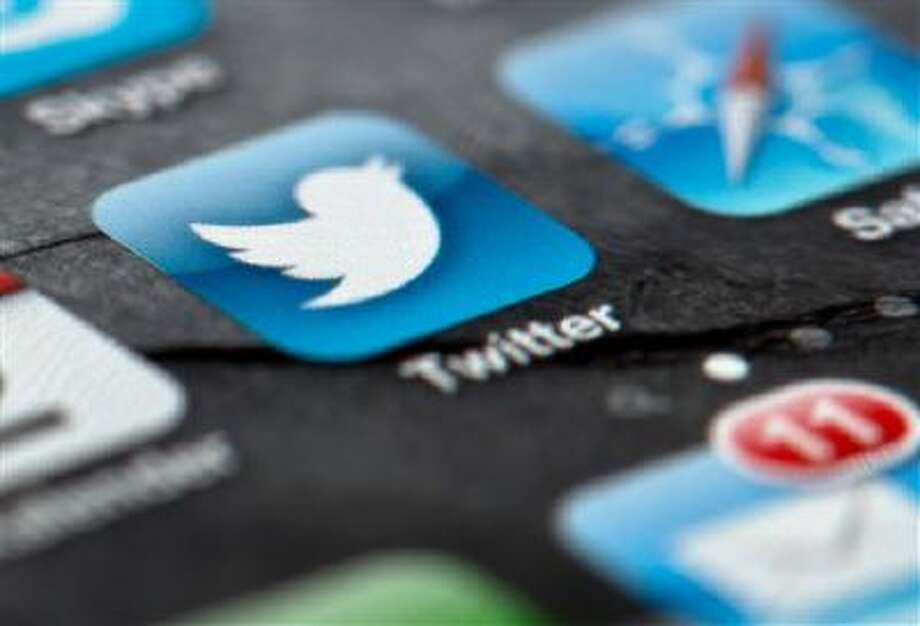 In this Feb. 2, 2013, file photo, a smartphone display shows the Twitter logo in Berlin, Germany, Twitter unsealed the documents Thursday, Oct. 3, 2013, for its planned initial public offering of stock and says it hopes to raise up to $1 billion. Photo: ASSOCIATED PRESS / A2013