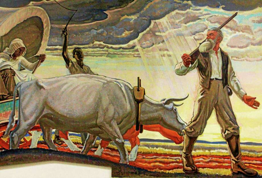 A photo of a mural by Arthur Covey painted in 1937 depicting John Brown escaping with slaves he freed from a Missouri plantation sits at the U.S. post office in Torrington. It is one of several paintings depicting Brown's life that was commissioned by the post office in 1937. Photo: Esteban L. Hernandez — Register Citizen