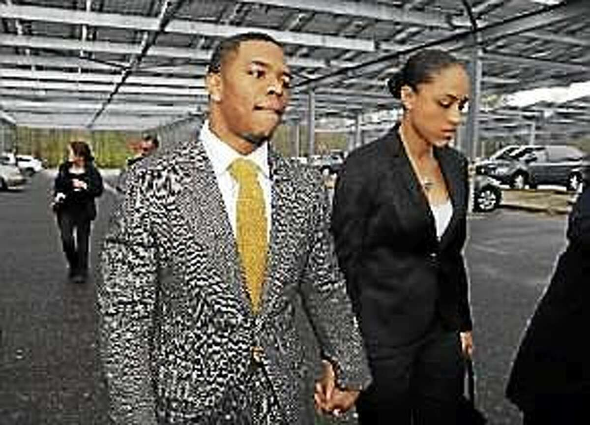 In this May 1, 2014, file photo, former Baltimore Ravens football player Ray Rice holds hands with his wife, Janay Palmer, as they arrive at Atlantic County Criminal Courthouse in Mays Landing, N.J.