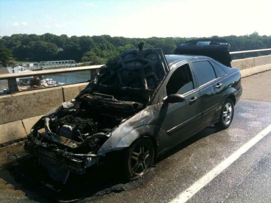 The Westport Fire Department responded to a car fire between exits 18 and 17 on Interstate 95 on June 19 at 9:13 a.m. The vehicle was quickly extinguished and the driver escaped without any injuries. Photo: Contributed Photo / Westport News