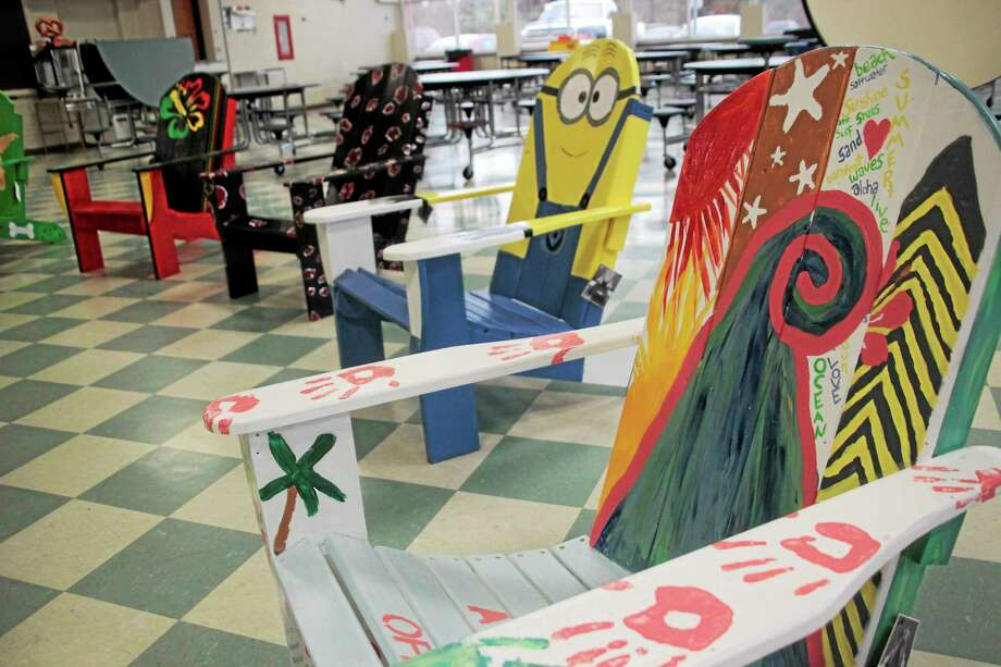 Painted Adirondack chairs in the silent auction. Photo: Shako Liu — Register Citizen