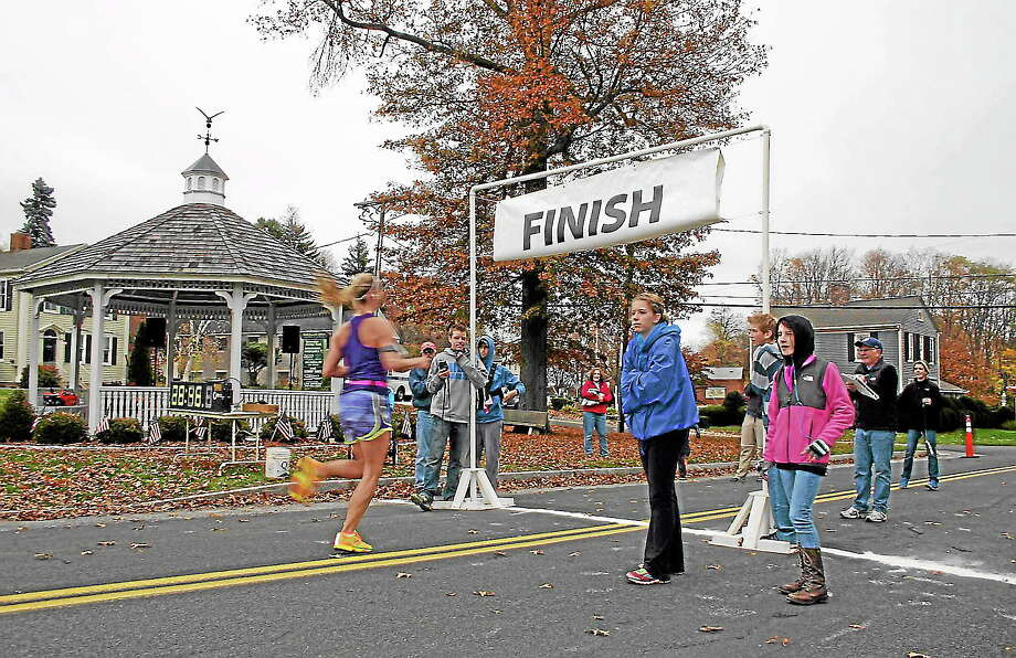 Runners cross the finish line during the 2012 Burlington 5K. Photo: Contributed Photo