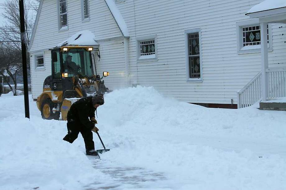 Snow crews were busy clearing away the Salisbury Bank parking lot, getting ready for the business day. Photos by Kathryn Boughton from North Canaan.
