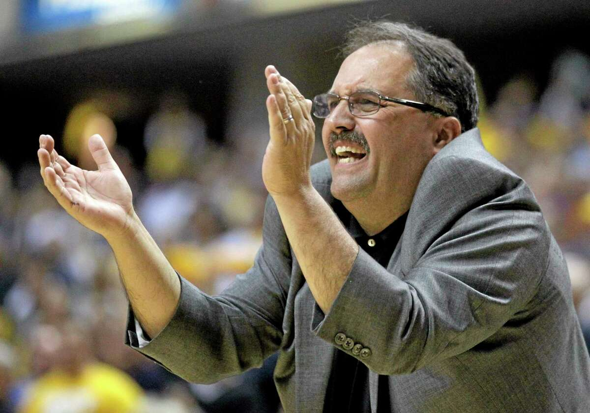 In this April 8, 2012 file photo, then-Orlando Magic head coach Stan Van Gundy gestures during a playoff game against the Pacers in Indianapolis. The Detroit Pistons say they have hired Van Gundy as their coach and president of basketball operations.