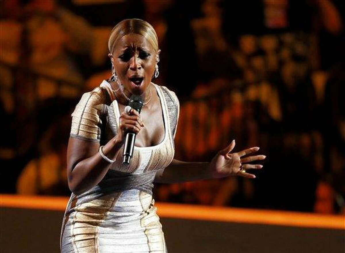 Mary J. Blige performing during the Democratic National Convention in Charlotte, N.C. Blige was honored Friday, Feb. 8, 2013 by Vibe magazine during a pre-Grammy party in Los Angeles. AP Photo/Carolyn Kaster