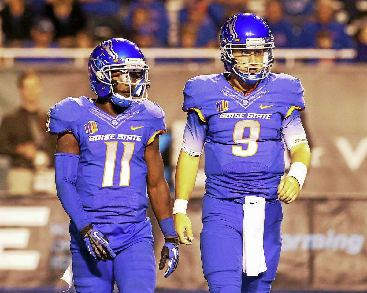 Boise State quarterback Grant Hedrick (9) and receiver Shane Williams-Rhodes (11) will look to attack the UConn defense, under the guidance of former Yale coach Mike Sanford, on Saturday.