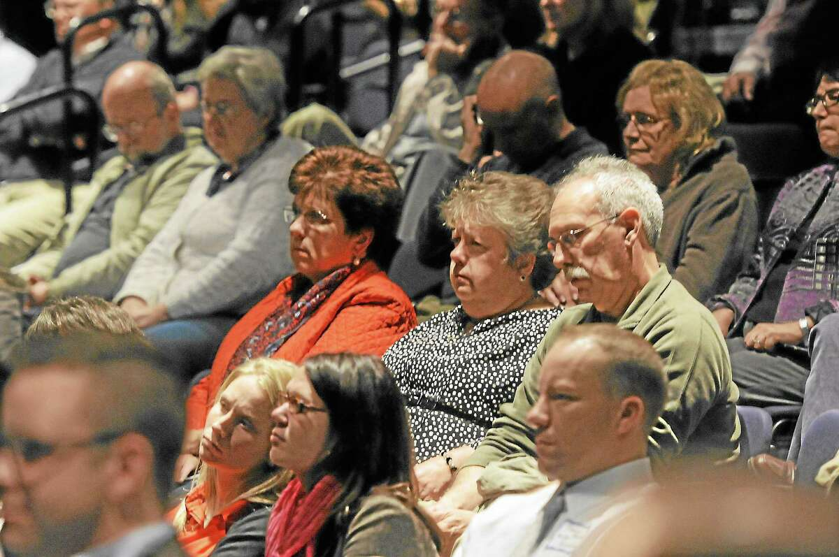 Citizens listen during a debate between Torrington mayoral candidates Elinor Carbone, a Republican, and Democrat George Craig at the Warner Theatre on Thursday, Oct. 24.