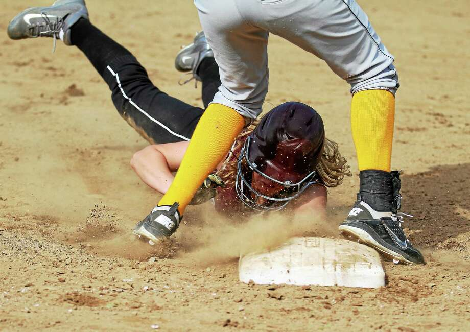 Torrington's Brittany Anderson dives into third base during the Red Raiders' 14-0 win over Kennedy. Photo: Marianne Killackey — Special To The Register Citizen  / 2013
