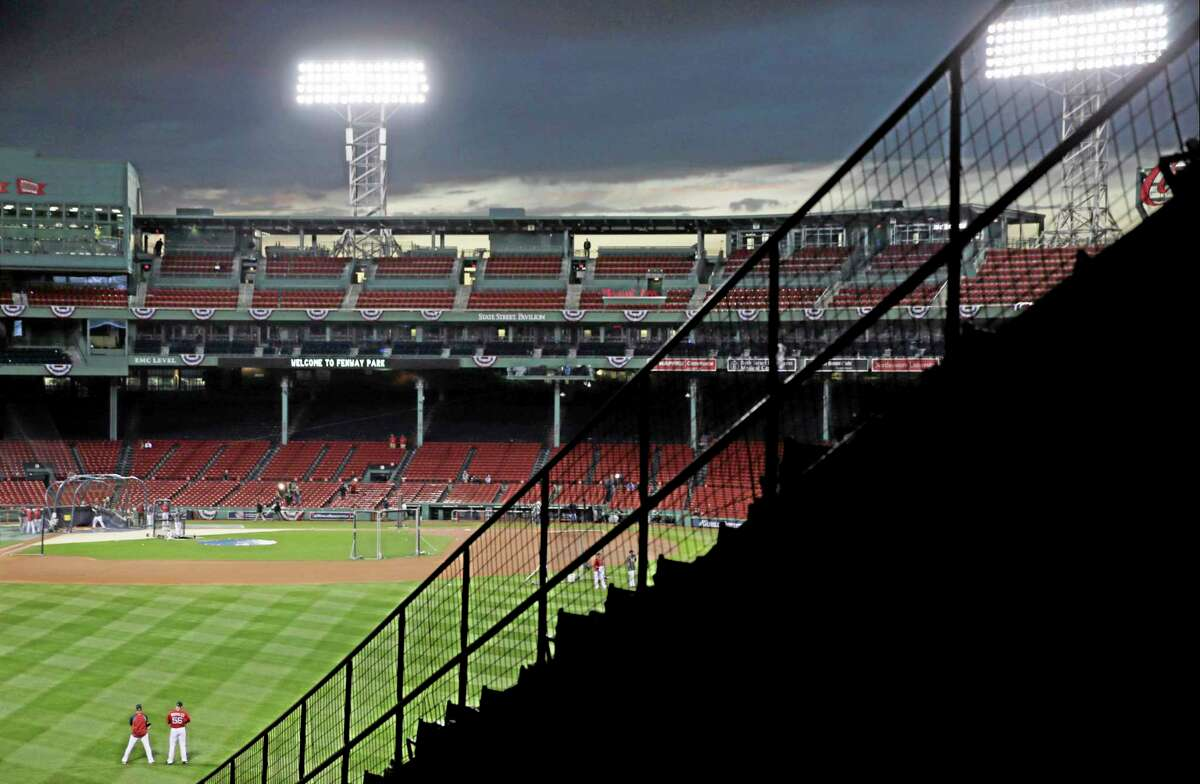 The Boston Red Sox take batting practice during a workout at Fenway Park Tuesday in Boston. The Red Sox will host the St. Louis Cardinals in Game 1 of the World Series on Wednesday.