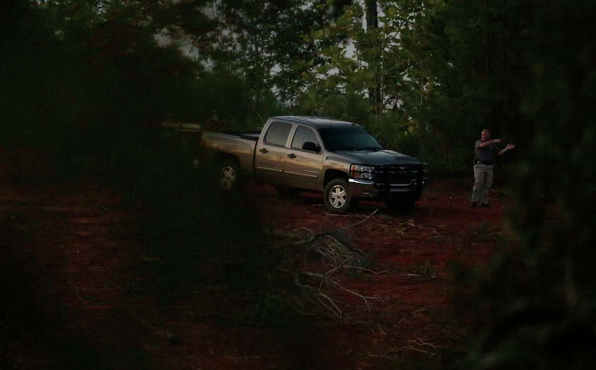 An investigator leads a truck near the crime scene on Tuesday, Sept. 9, 2014, in Camden, Ala. Wilcox County, Alabama, District Attorney Michael Jackson told The Associated Press that Timothy Ray Jones Jr. is suspected of killing his children in South Carolina and leaving their bodies in a rural area near Camden. (AP Photo/Brynn Anderson)