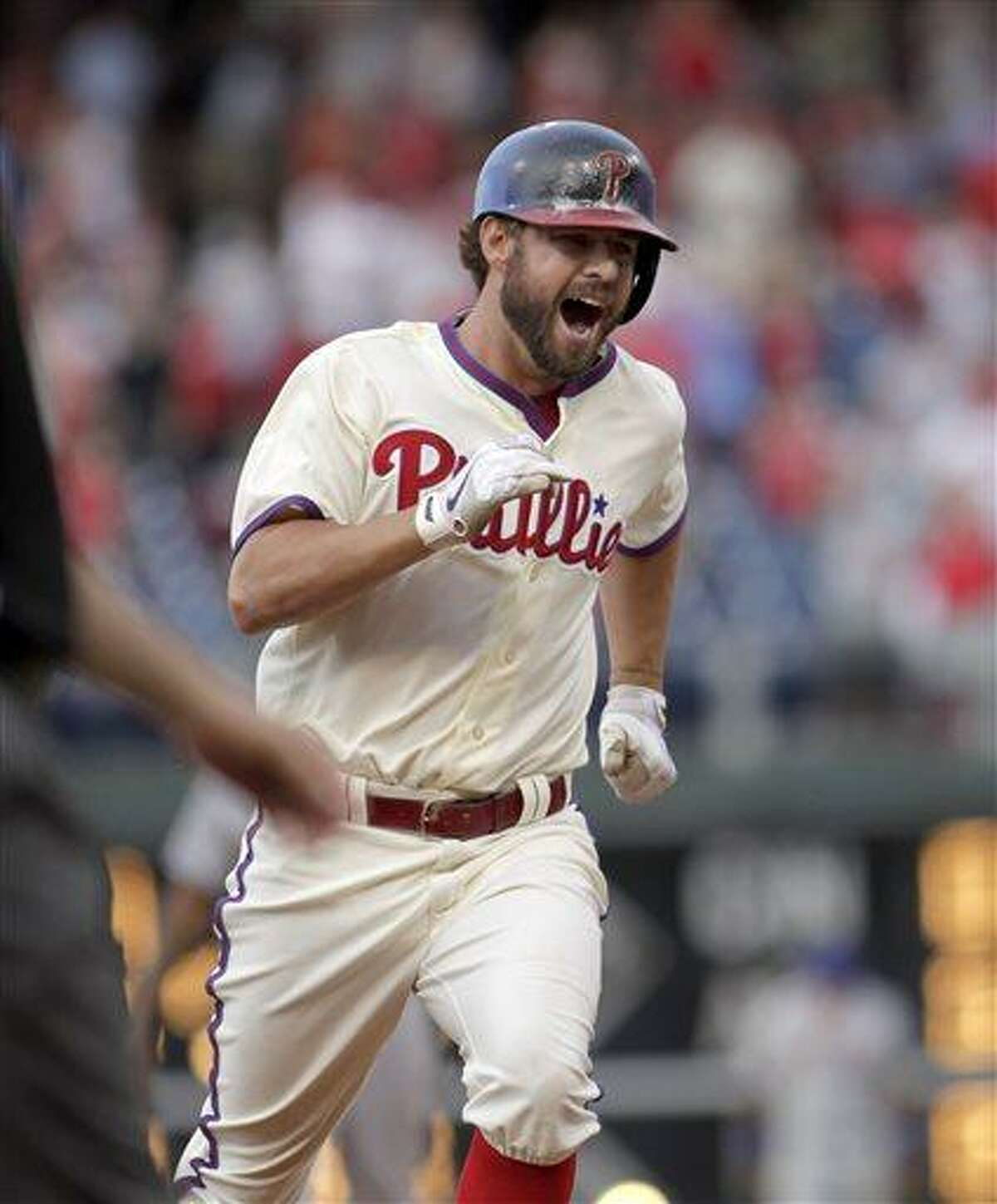 Philadelphia Phillies' Kevin Frandsen runs the bases after he hit a solo home run against the New York Mets in the ninth inning of a baseball game Saturday, June 22, 2013, in Philadelphia. The Phillies won 8-7. (AP Photo/H. Rumph Jr)