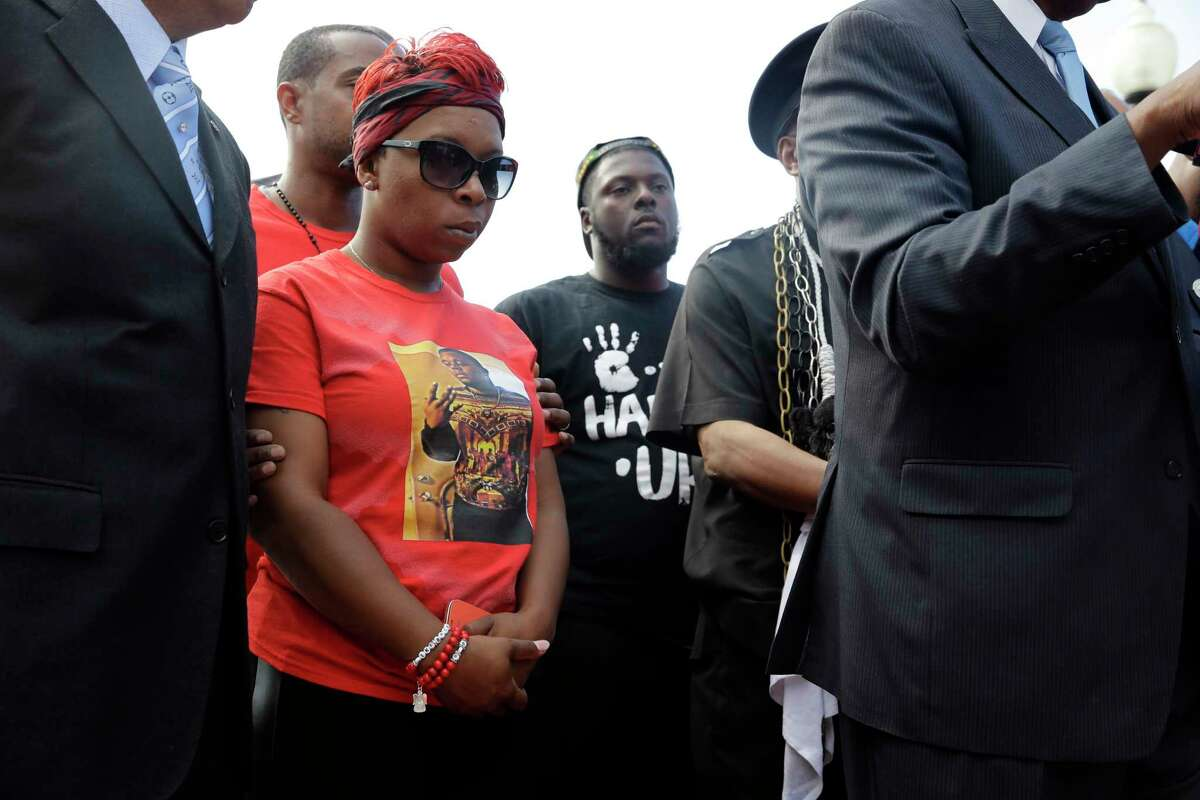 Lesley McSpadden, the mother of Michael Brown, listens during a news conference Tuesday, Sept. 9, 2014, in Ferguson, Mo. The news conference was held to call for the arrest of Darren Wilson, the Ferguson police officer responsible for Michael Brown's fatal shooting on Aug. 9. (AP Photo/Jeff Roberson)
