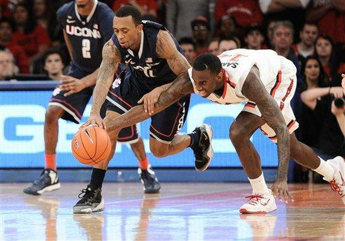 Feb. 6, 2013 - New York City, NY, USA - Wednesday February 6, 2013: Connecticut Huskies guard Ryan Boatright (11) and St. John's Red Storm forward Jakarr Sampson (14) battle for a loose ball during the 1st half of the NCAA basketball game between Connecticut and St. John's at Madison Square Garden in New York City, NY. ST. Johns held off a gritty Connecticut 71-65. Bill Shettle / Cal Sport Media. (Cal Sport Media via AP Images)