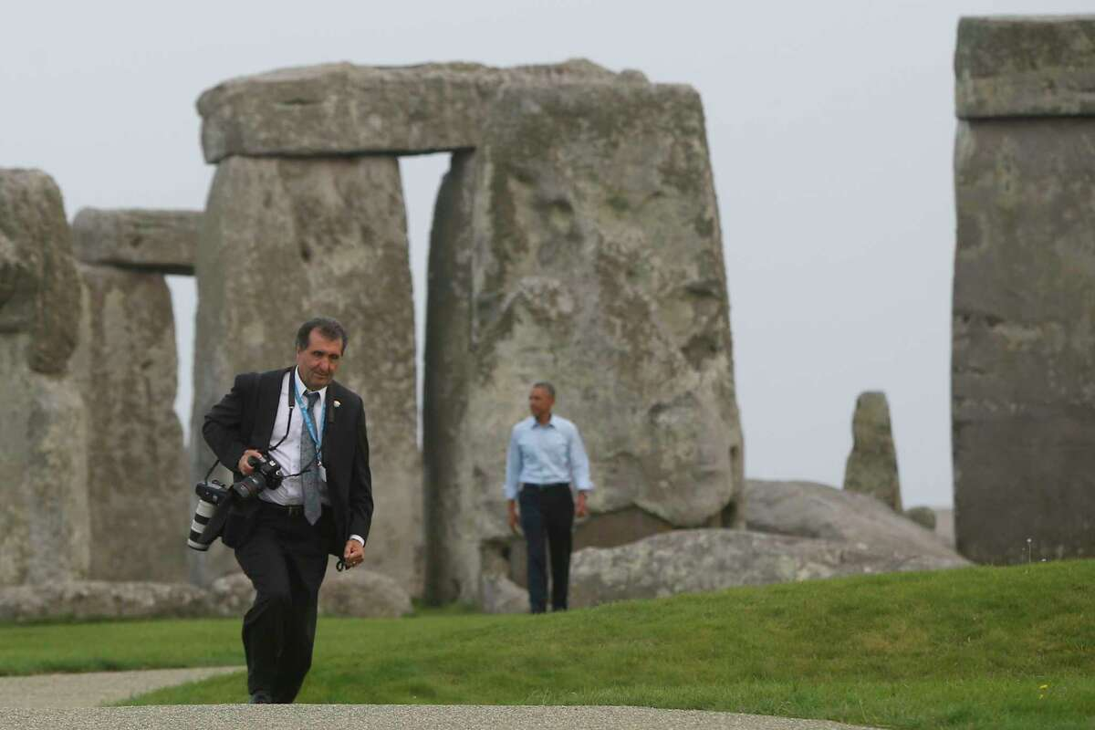 White House photographer Pete Souza, left, walks ahead of President Barack Obama during a visit to Stonehenge in Amesbury, Wiltshire, England, Friday, Sept. 5, 2014. (AP Photo/Charles Dharapak)