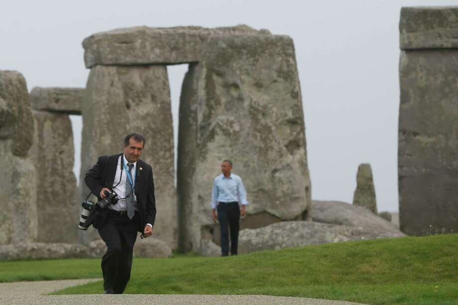White House photographer Pete Souza, left, walks ahead of President Barack Obama during a visit to Stonehenge in Amesbury, Wiltshire, England, Friday, Sept. 5, 2014. (AP Photo/Charles Dharapak) Photo: AP / AP
