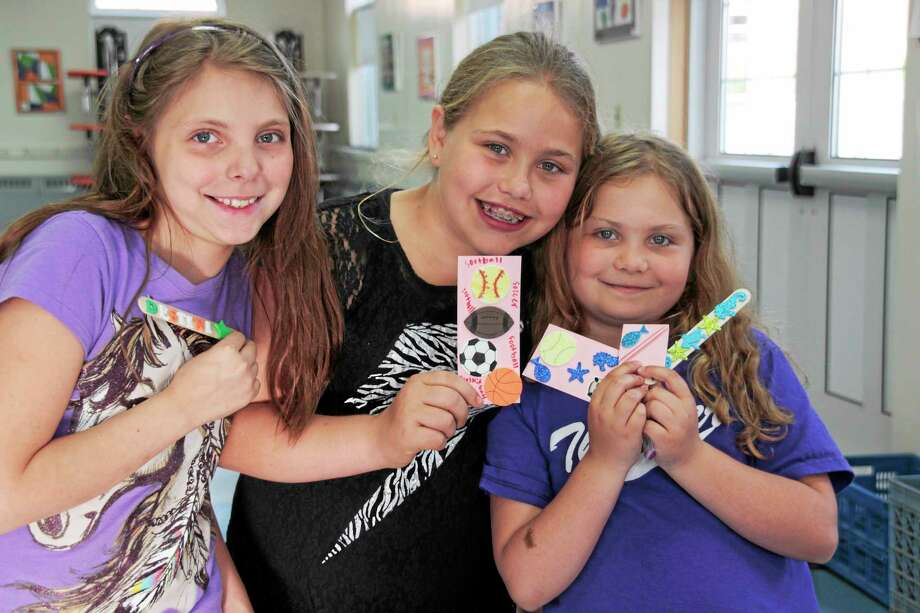 Children showcased their hand made book marks at the family craft event Tuesday. Photo: Shako Liu — Register Citizen