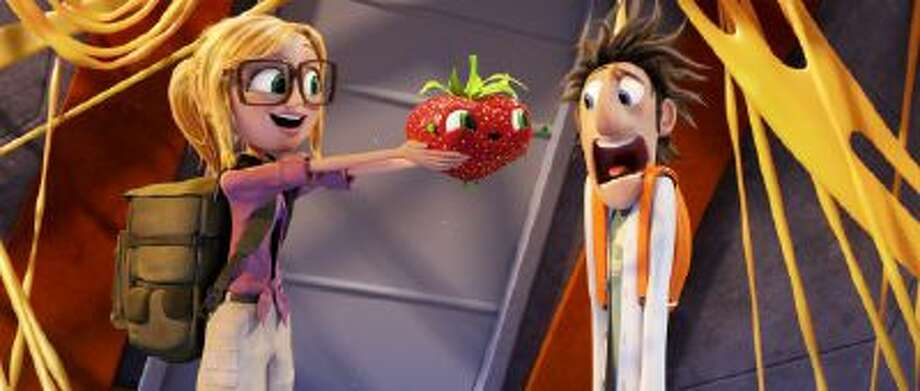 """This film image released by Sony Pictures Animation shows characters, from left, Sam Sparks, voiced by Anna Faris, Barry the Strawberry, voiced by Cody Cameron, and Flint Lockwood, voiced by Bill Hader in a scene from """"Cloudy with a Chance of Meatballs."""""""
