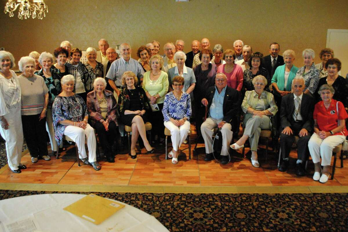 The class of 1948 sits together, 65 years after graduation. Jessica Glenza - Register Citizen