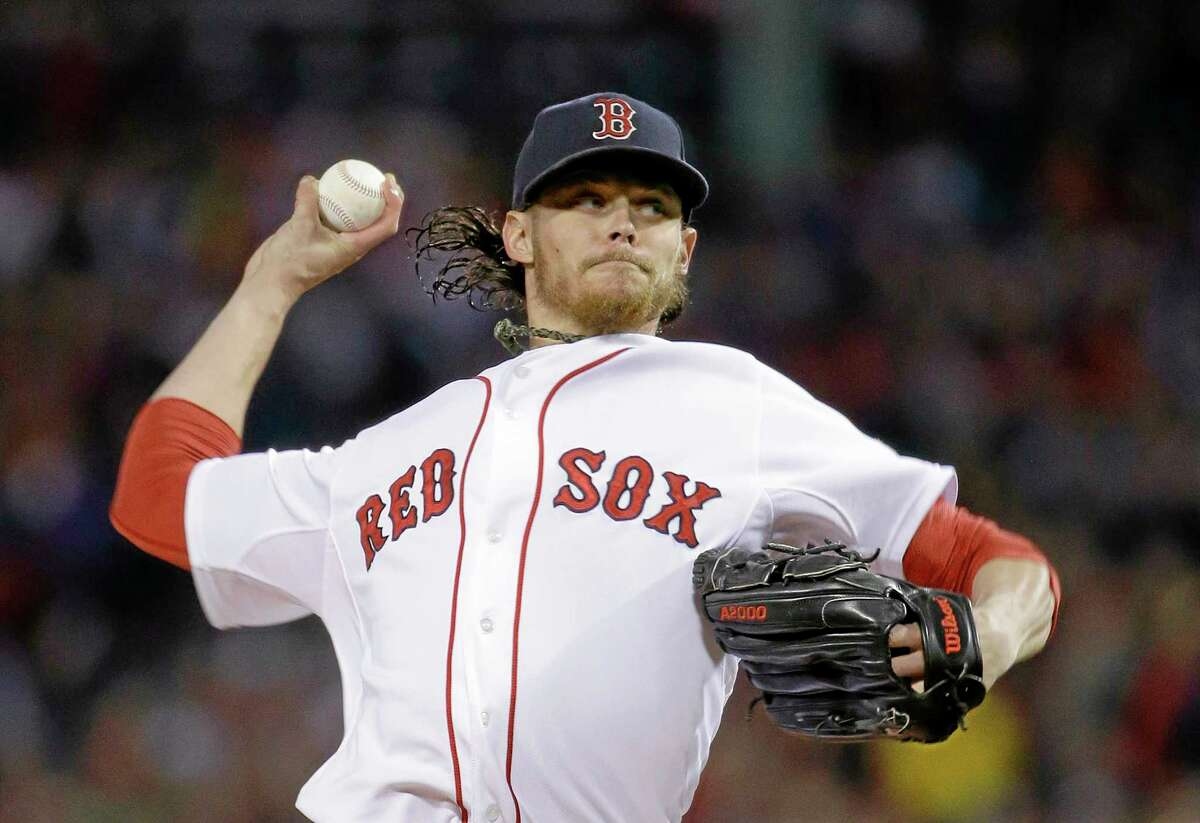 Red Sox starting pitcher Clay Buchholz throws in the first inning of Game 6 of the American League championship series on Saturday in Boston.