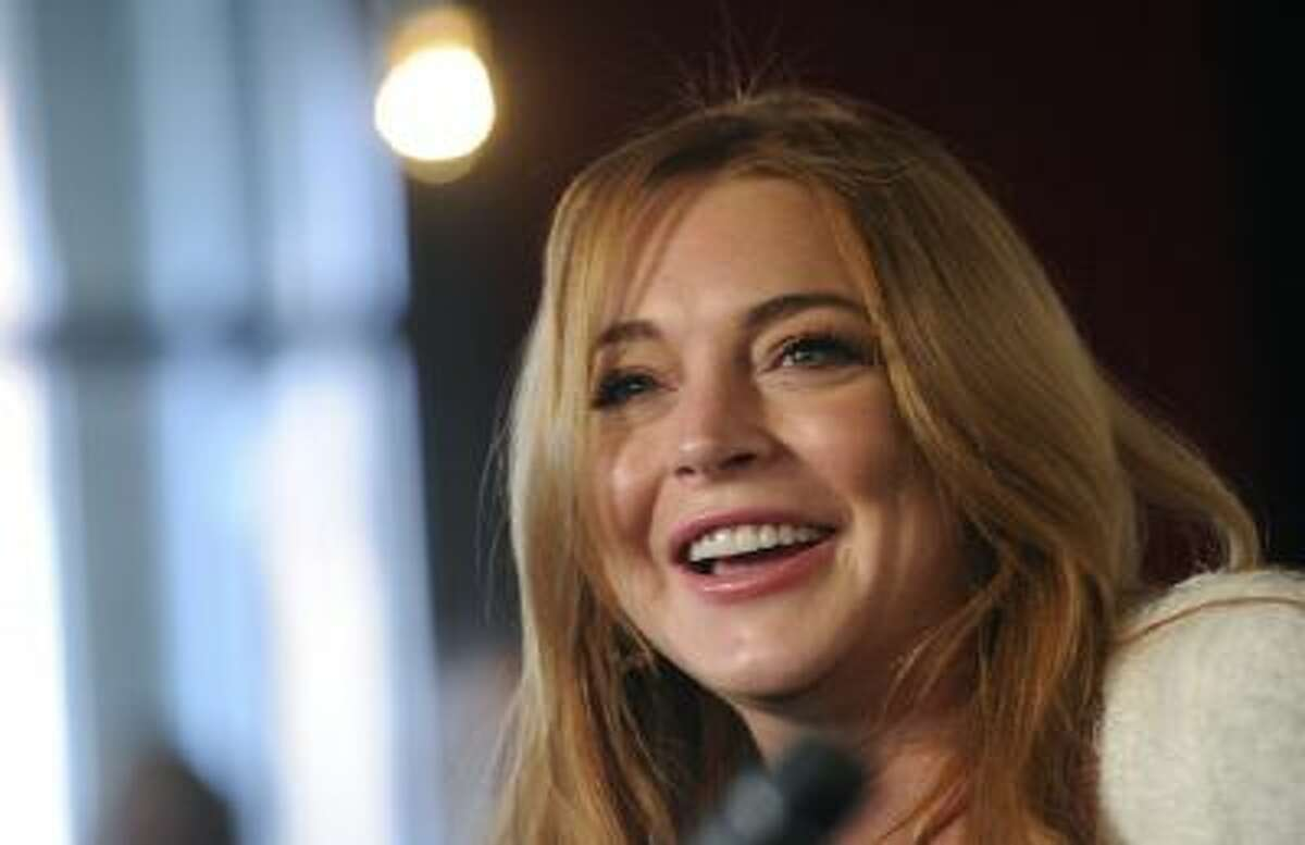 Actress Lindsay Lohan addresses reporters during a news conference at the 2014 Sundance Film Festival, Monday, Jan. 20, 2014, in Park City, Utah. Producer Randall Emmett and Lohan announced the forthcoming production of a new film,