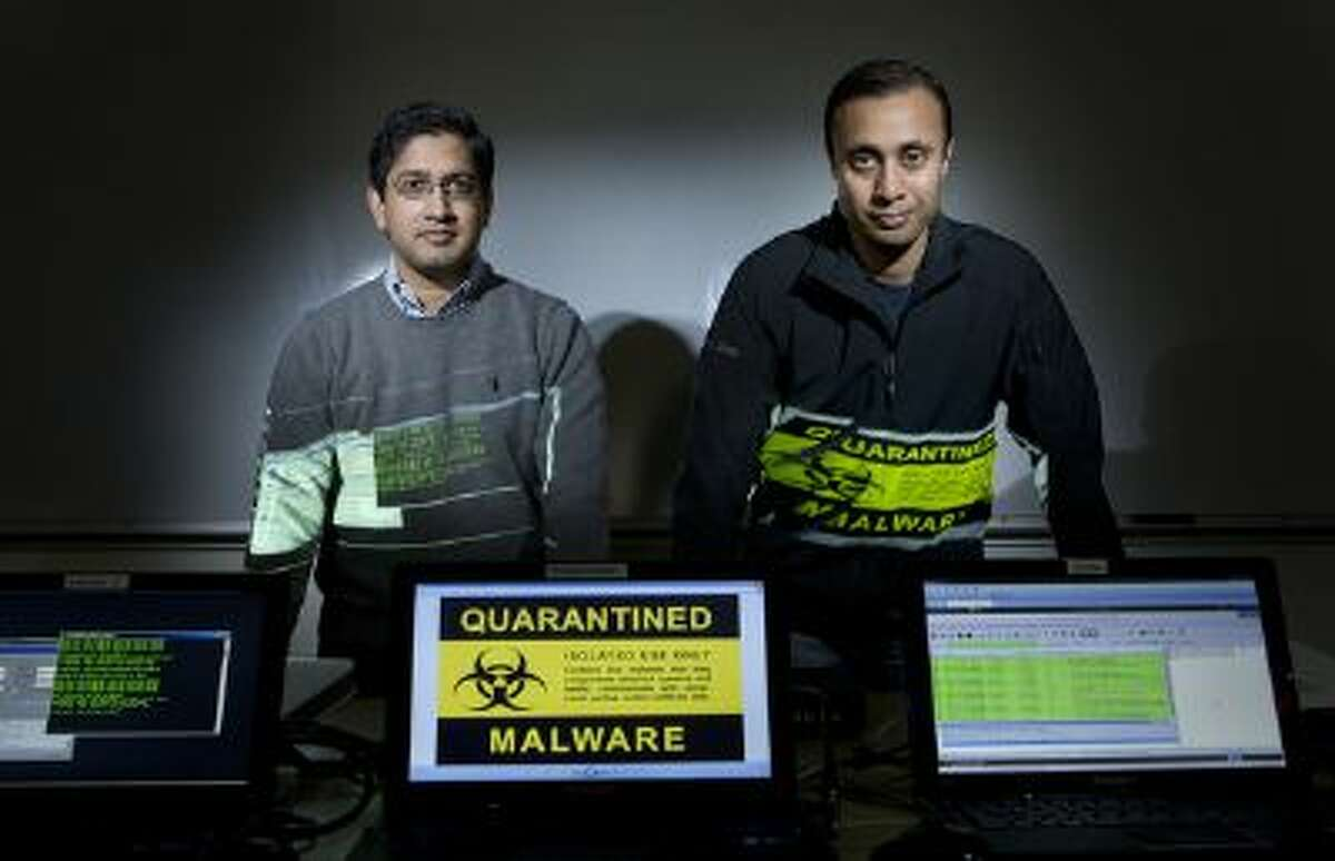 From right, Shape Security co-founder Sumit Agarwal and V.P. of Strategy Shuman Ghosemajumder at Shape's offices in Mountain View, on Friday, Jan. 10, 2014.