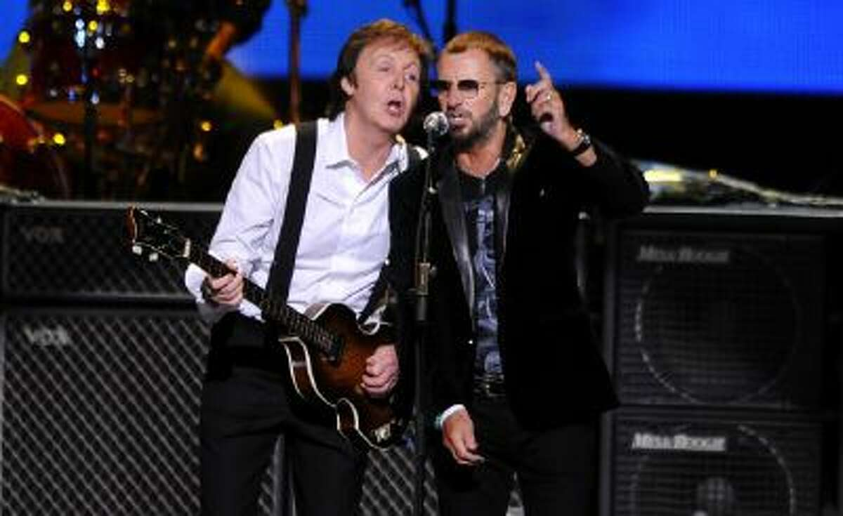 his April 4, 2009 file photo shows Paul McCartney, left, and Ringo Starr performing at the Change Begins Within Concert in New York. The Recording Academy announced Tuesday, Jan 14, 2014, that both McCartney and Starr will perform at the Jan. 26 Grammy awards show. The Beatles will be honored at the Academy?s Special Merits Awards a day before, and a day after the big show, the iconic group will be the center of a performance special featuring Eurythmics and other acts playing Beatles hits.