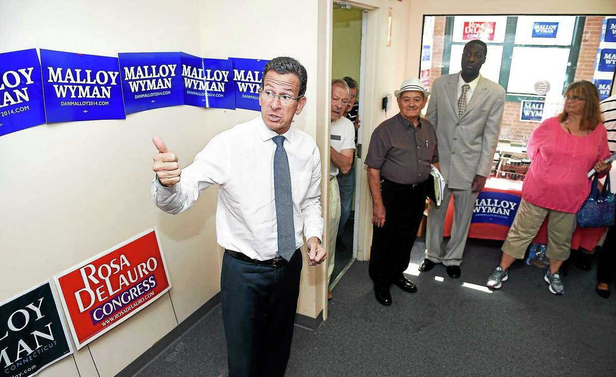 (Arnold Gold-New Haven Register) Governor Dannel Malloy talks with campaign volunteers at the Connecticut Democratic Party offices in New Haven.