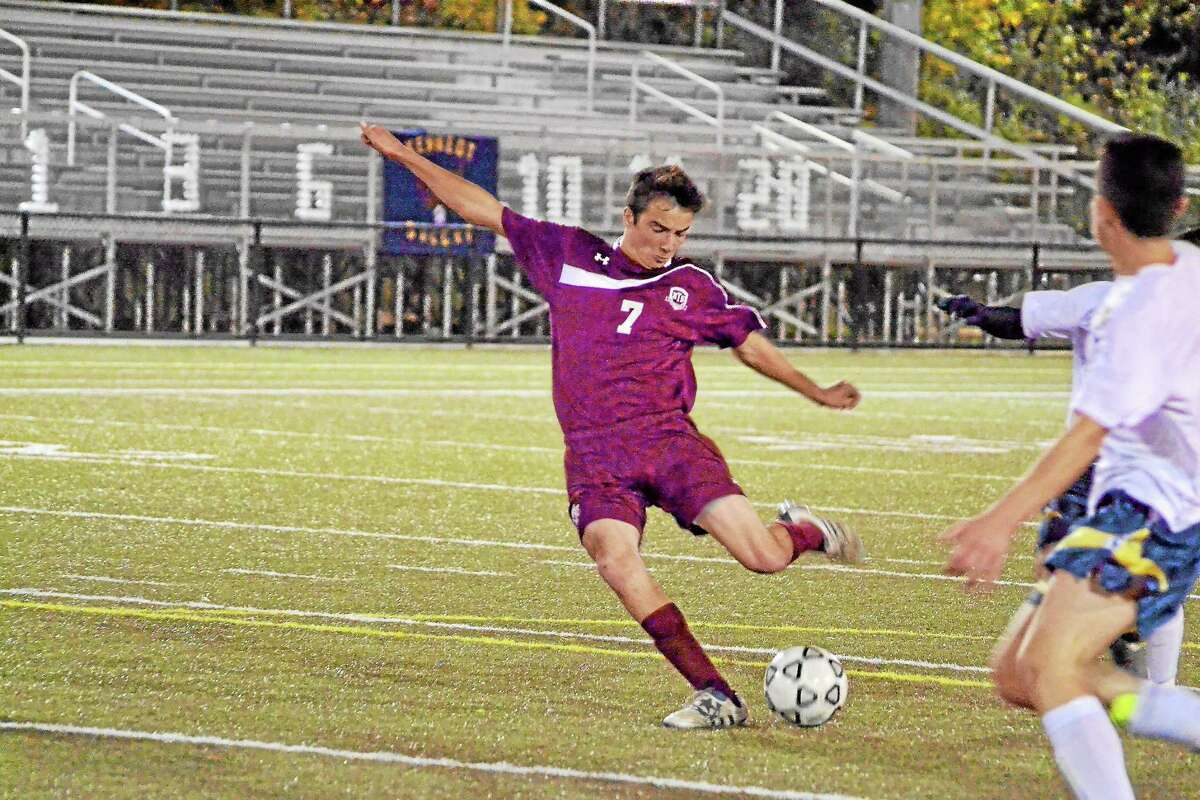 Torrington's Shane Bierfeldt scores the first of his three goals in Torrington's 7-0 win over Kennedy.