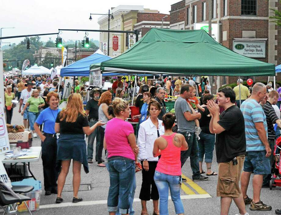 Hundreds of people attended a Torrington Main Street Marketplace event in August 2013. Photo: John Berry — Register Citizen